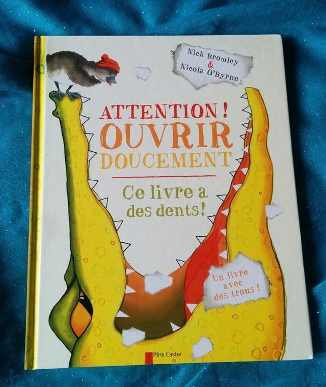 """""""Attention ! Ouvrir doucement. Ce livre a des dents !"""""""